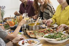 Party with vegan food. Young people at a party in their house with vegan food on the table stock photos