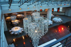 Party venue. Chandelier, dance floor and tables at a party venue Royalty Free Stock Photography