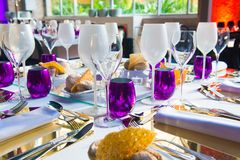Wedding Party, Table Decoration, Catering Event, Purple and White Decoration. Table set decoration in purple, crystal, silver and white tones. Silvery cutlery Royalty Free Stock Images