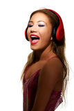 Party woman with headphones listening to music. Stock Photo