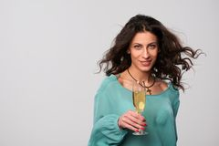 Party woman holding glass with champagne Royalty Free Stock Images