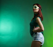 Party woman with mask. A young woman with a mask wearing party outfit Stock Photo
