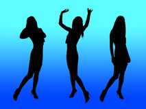 Party women silhouettes. Three happy women on the party and blue lights Stock Photos