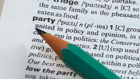 Party word definition on vocabulary page, political group united in opinion stock video