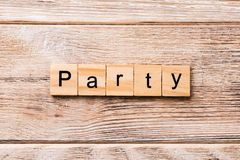 PARTY word written on wood block. PARTY text on wooden table for your desing, concept.  royalty free stock images