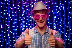 Party young man with hat and glasses Stock Image