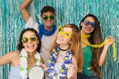 Partygoers are celebrating Carnival in Brazil. People in colorful and happy sunglasses.. stock photo
