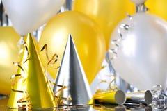 Partyhüte und -ballone Lizenzfreies Stockbild