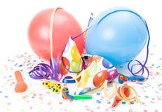 Partyhüte und -ballone Lizenzfreies Stockfoto