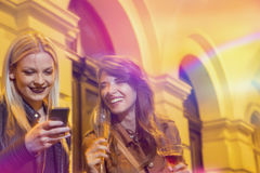 Partying. Two beautiful girls drinking and having fun on a girls' night out royalty free stock photo