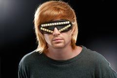 Partyjna chłopiec w świetlicowych szkłach Fotografia Royalty Free