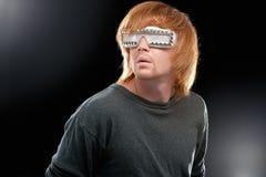 Partyjna chłopiec w świetlicowych szkłach Zdjęcia Stock