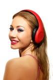 Partyjna kobieta słucha muzyka z hełmofonami Obrazy Stock