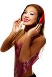 Partyjna kobieta słucha muzyka z hełmofonami Fotografia Stock