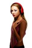 Partyjna kobieta słucha muzyka z hełmofonami Obrazy Royalty Free
