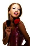 Partyjna kobieta słucha muzyka z hełmofonami Obraz Stock