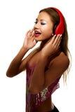 Partyjna kobieta słucha muzyka z hełmofonami Obraz Royalty Free
