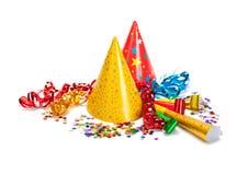 Partyschutzkappen, -Confetti und -ausläufer Lizenzfreie Stockfotos
