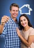 Pary mienia klucz z domową ikoną przed winietą Zdjęcie Stock