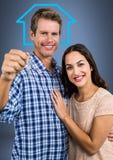Pary mienia klucz z domową ikoną przed winietą Obrazy Stock