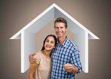 Pary mienia klucz z domową ikoną przed winietą Zdjęcia Stock