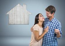 Pary mienia klucz z domową ikoną przed winietą Zdjęcie Royalty Free