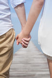 Pary mienia ręka plażą Fotografia Stock
