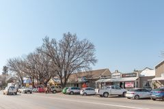 Street scene with businesses, people and vehicles in Parys. PARYS, SOUTH AFRICA, AUGUST 2, 2018: A street scene with businesses, people and vehicles, in Parys in stock images