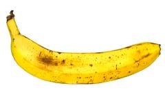 pas une banane parfaite sur le fond blanc Photos stock