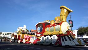 Train and piano float in the famous Rose Parade. Pasadena,  JAN 1: Train and piano float in the famous Rose Parade - America`s New Year Celebration on JAN 1 stock video footage