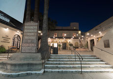 The Pasadena Playhouse neon sign. The Pasadena Playhouse is a famous theater in Pasadena, California. Entrance of the building shown at dusk Stock Photo