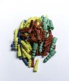Pasadores plásticos coloreados Fotos de archivo