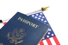 Pasaporte americano en una bandera americana Imágenes de archivo libres de regalías