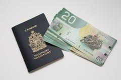 Pasaporte canadiense con las cuentas de dólar Imágenes de archivo libres de regalías
