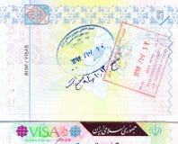 Pasaporte con los sellos de la visa, de la entrada y de la salida de Irán Fotografía de archivo