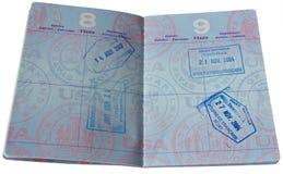Pasaporte con los sellos de VISA Foto de archivo