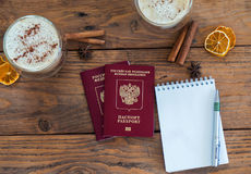 Pasaporte, cuaderno y taza de café Imagenes de archivo