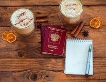 Pasaporte, cuaderno y taza de café Imágenes de archivo libres de regalías