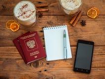 Pasaporte, cuaderno y taza de café Imagen de archivo libre de regalías