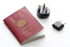 Pasaporte japonés y enchufe eléctrico imágenes de archivo libres de regalías