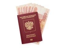 Pasaporte ruso con el dinero Imagenes de archivo