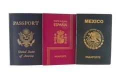Pasaporte tres (americano, mexicano y español) Foto de archivo libre de regalías