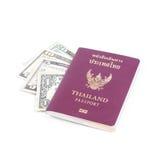 Pasaporte y dólar los E.E.U.U. de Tailandia Foto de archivo libre de regalías