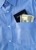 Pasaporte y dinero americano Fotos de archivo libres de regalías