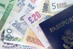 Pasaporte y moneda extranjera Fotografía de archivo
