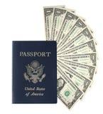 Pasaporte y un ventilador del dinero Foto de archivo libre de regalías