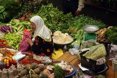 Pasar Siti Khadijah (Kota Bharu Central Market), Kelantan, Malaysia. Stock image of Muslim woman selling fresh vegetables at market in Kota Bharu, Malaysia Stock Photography