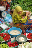 Pasar Siti Khadijah (Kota Bharu Central Market), Kelantan, Malaysia. Stock image of Muslim woman selling fresh vegetables at market in Kota Bharu, Malaysia royalty free stock images
