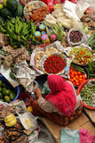 Pasar Siti Khadijah (Kota Bharu Central Market), Kelantan, Malaysia. Stock image of Muslim woman selling fresh vegetables at market in Kota Bharu, Malaysia royalty free stock photo