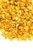 Pasas brillantes de oro aisladas en el fondo blanco. Grande amarillo Imágenes de archivo libres de regalías